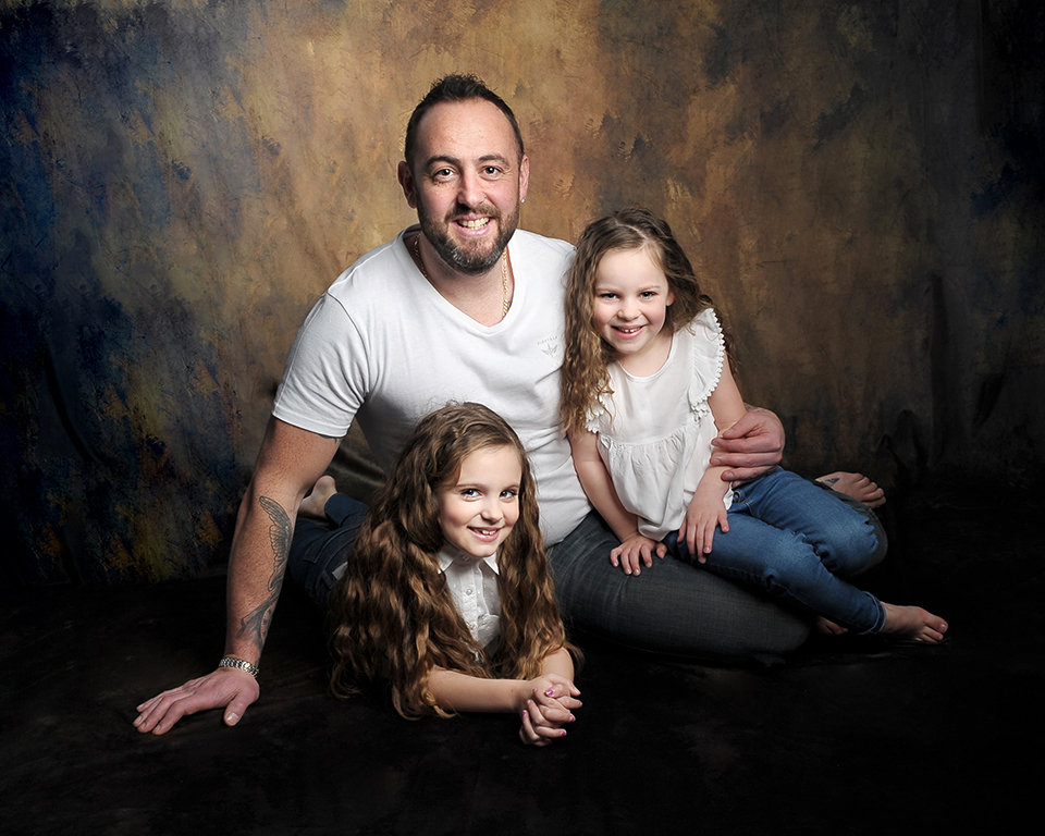 Family Photograph (dad and two girls) taken by Treasured Moments Photography