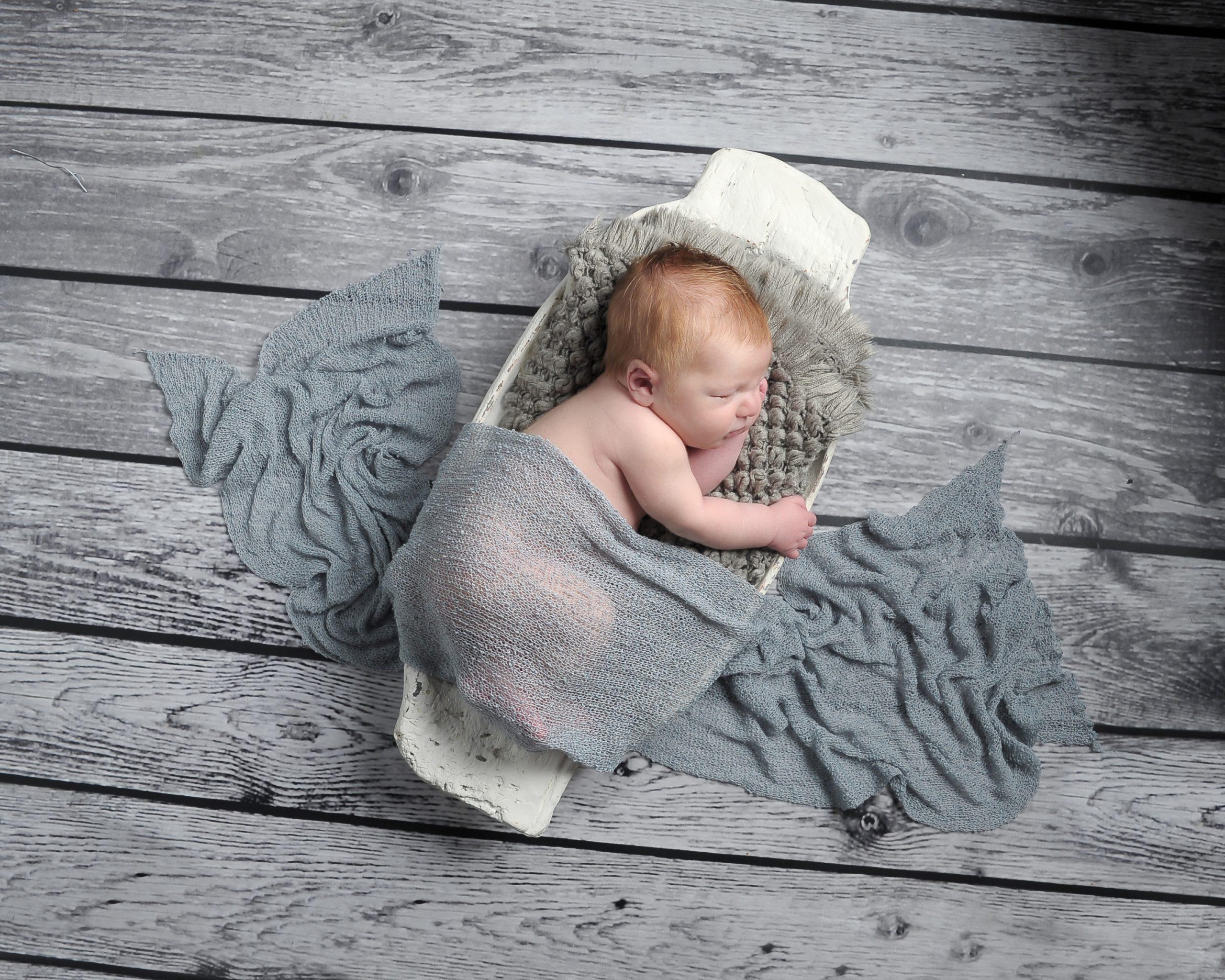 Newborn baby born sleeping in bowl