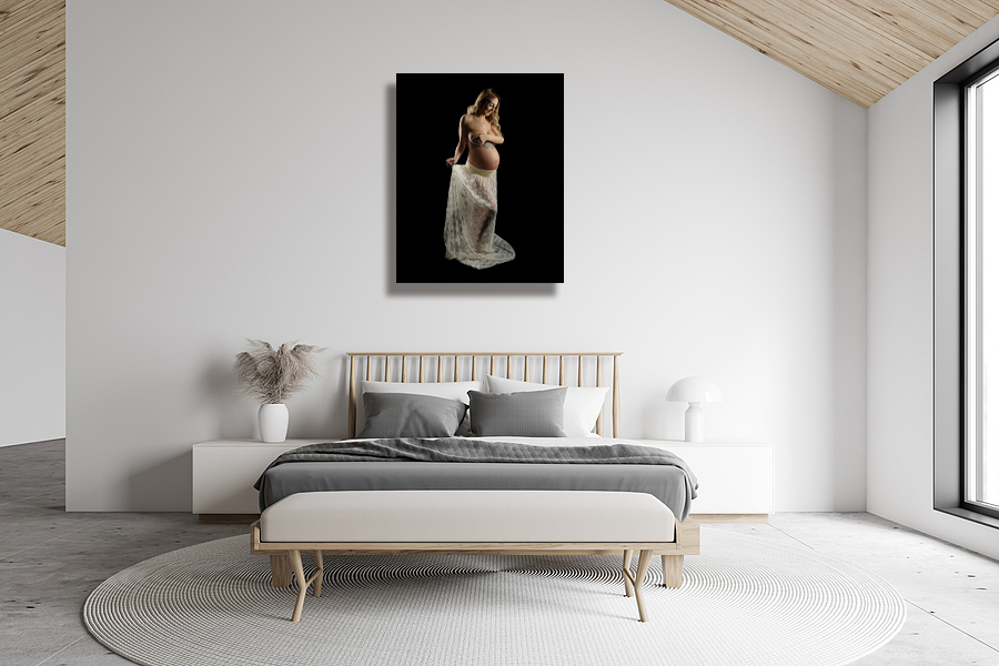 White Attic Master Bedroom Interior with maternity canvas on wall