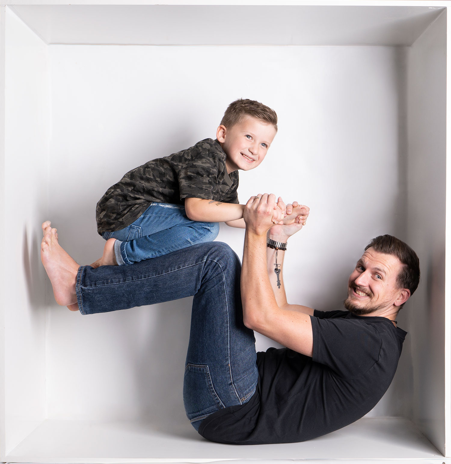 Daddy and son playing in the box